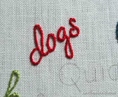 hand embroidered lettering stem stitch on a small word