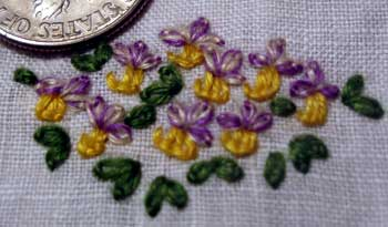 Separated strands of floche in hand embroidered flowers