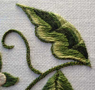 Hand embroidered green leaf