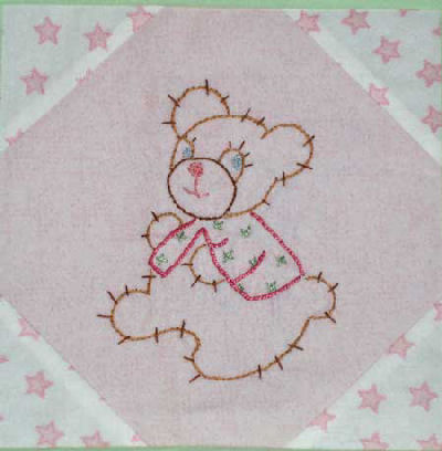 Flannel Baby Quilt with Hand Embroidered Squares