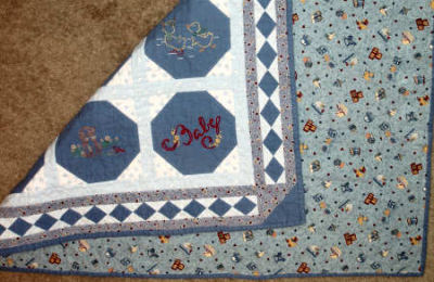 Embroidered Baby Quilt in flannel - back