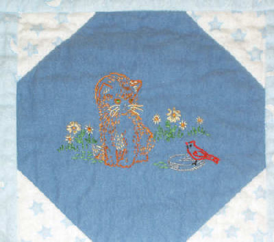 Embroidered Baby Quilt in flannel - kitten and bird