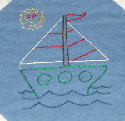 Embroidered Baby Quilt in flannel - sailboat