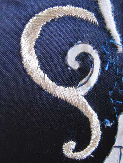 Satin Stitching with Metal Threads: Fleur-de-lis in silver thread on blue silk ground