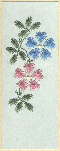 Hand embroidered bookmark on paper