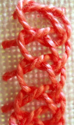 Half of a plaited braid stitch