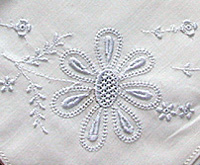 Detail of hand embroidered handkerchief in whitework techniques