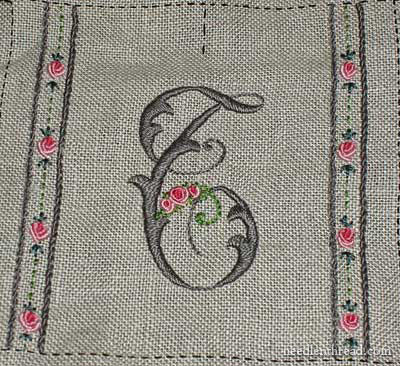 Embroidered needlebook progress - repaired monogram