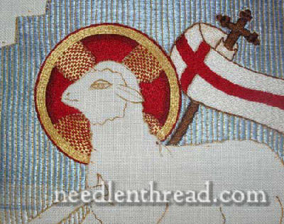 Close up on halo, gold couched with red silk