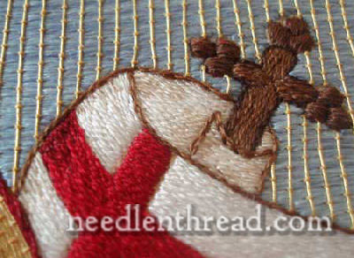 Agnus Dei banner worked in silk in stem stitch