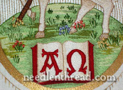 Hand Embroidered Agnus Dei - embroidered hill with flowers