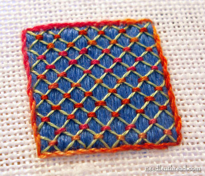 Lattice work over satin stitch