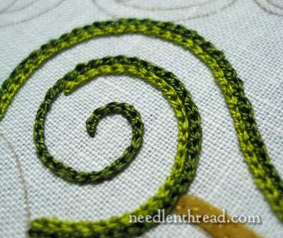 Jacobean Jumble embroidery project: chain stitch swirl worked in silk