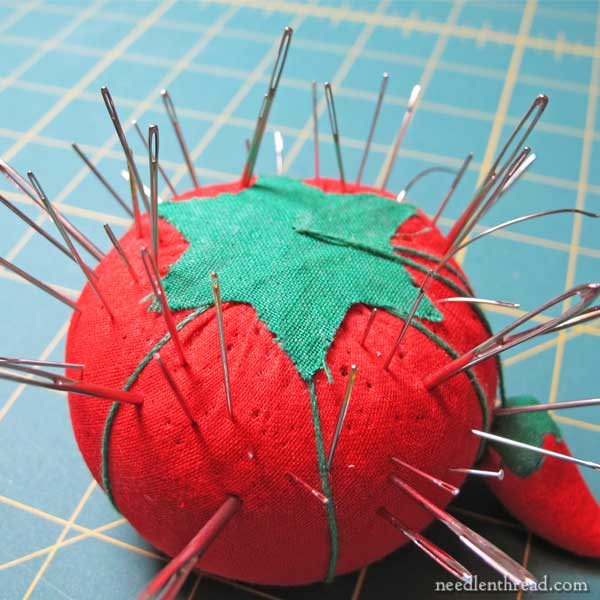 Pincushion with embroidery needles