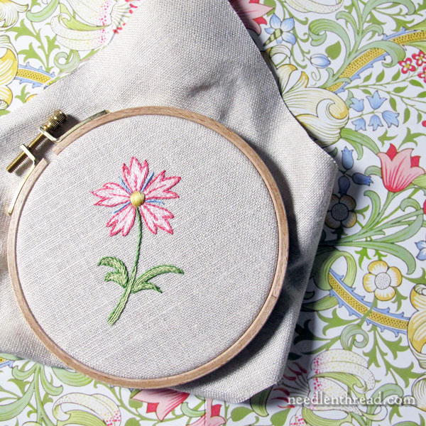 Hand embroidered flower in floche thread - finding color inspiration for embroidery