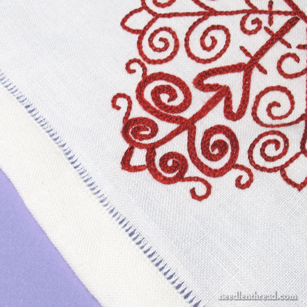 Hem stitching on an embroidered redwork table runner