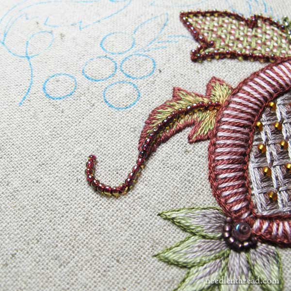 Beaded Palestrina stitch outlines around leaves