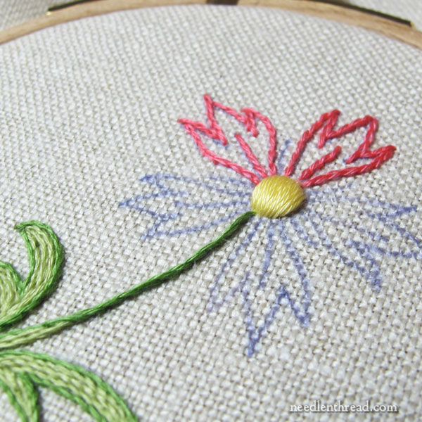 Embroidery with cotton floche on linen fabric