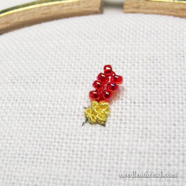 flat chain stitch line worked with beads