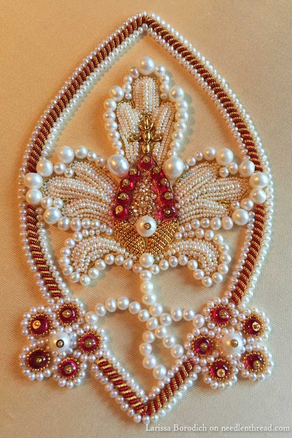 Stylized pomegranate in pearl goldwork embroidery