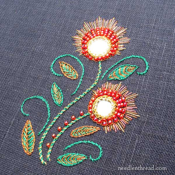 shisha embroidery with metallic threads on dark fabric