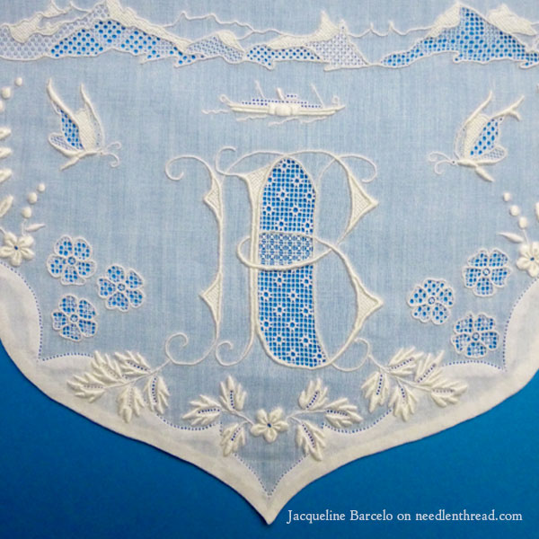 Fine whitework embroidery, monogram, and needle lace on muslin