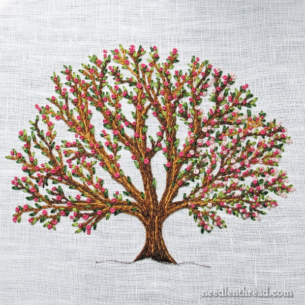 Hand Embroidered Tree, Blooming, worked with split stitch, seed stitch, and French knots