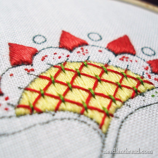 Embroidery with satin stitch and floche