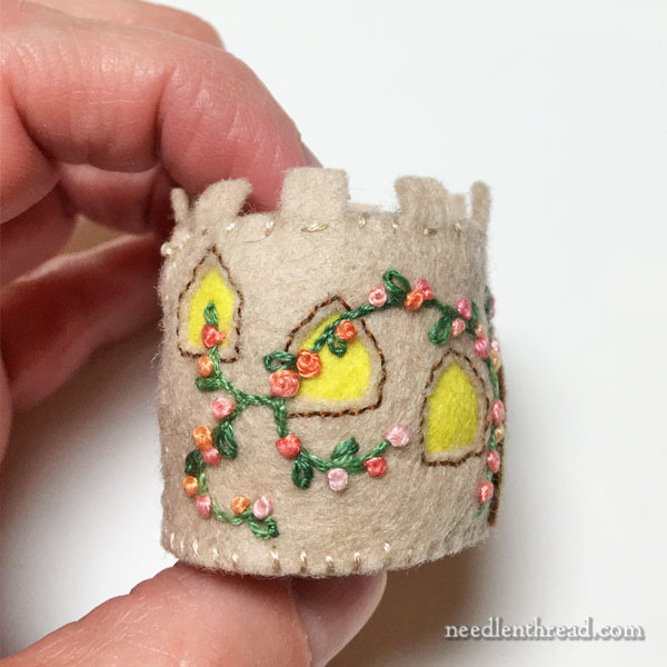 Bottle cap pincushion with embroidered felt