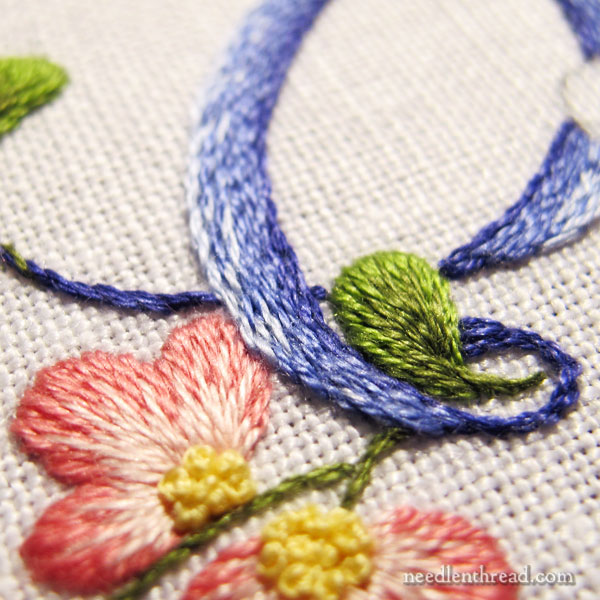 E Monogram embroidered in shaded stem stitch filling