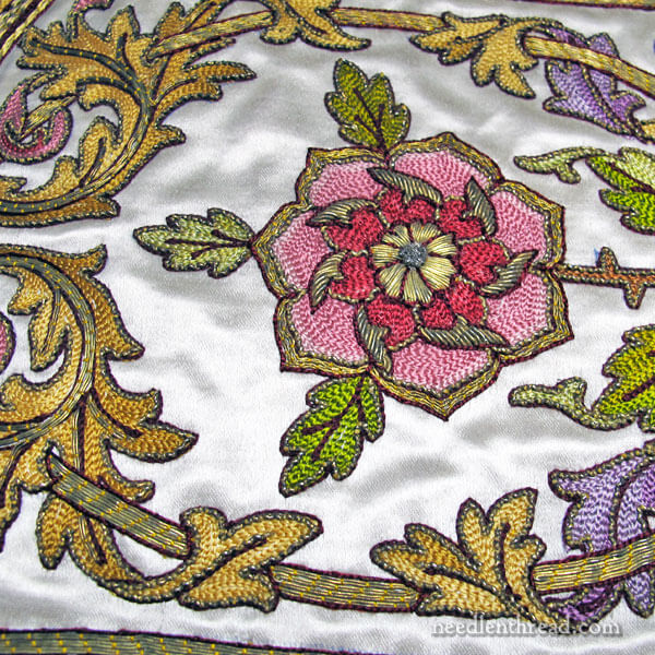 Rose embroidered in chain stitch with goldwork on vestment repair