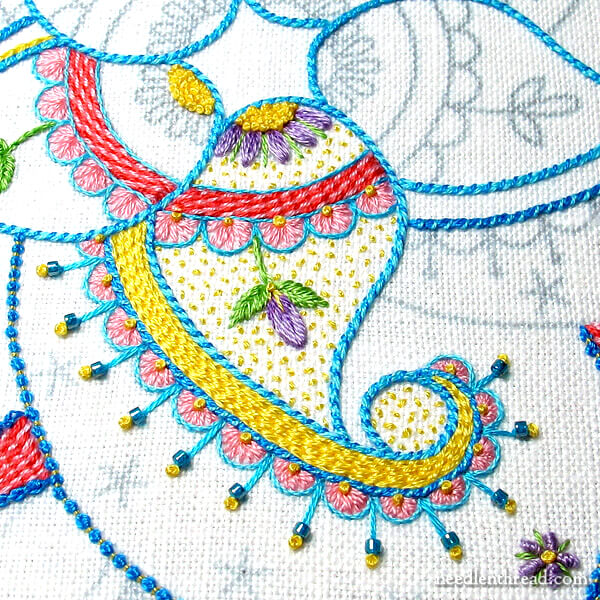 Embroidered paisley kaleidoscope with colors and stitches