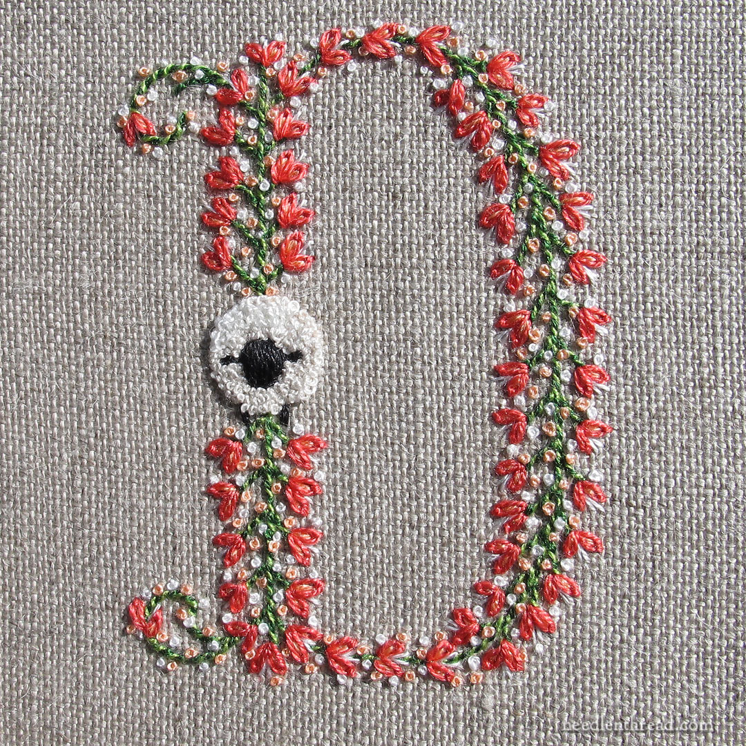 Monogram D embroidered with sheep lamb motif
