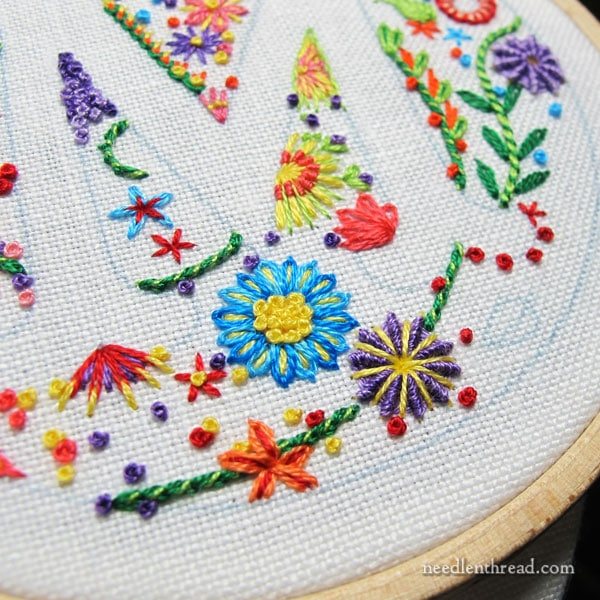 voided monogram m in embroidery