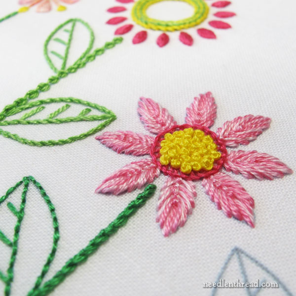 Embroidered Line of Stylized Flowers for household linens