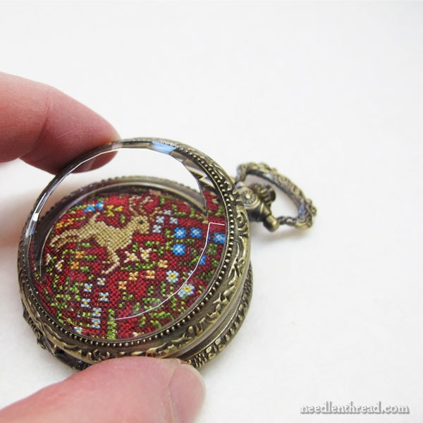 Silk Gauze embroidery finished in a pocket watch setting