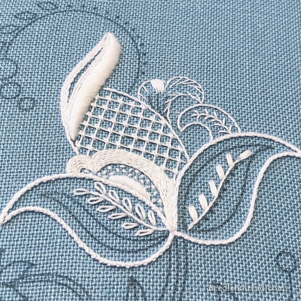 Jacobean whitework embroidery on blue linen