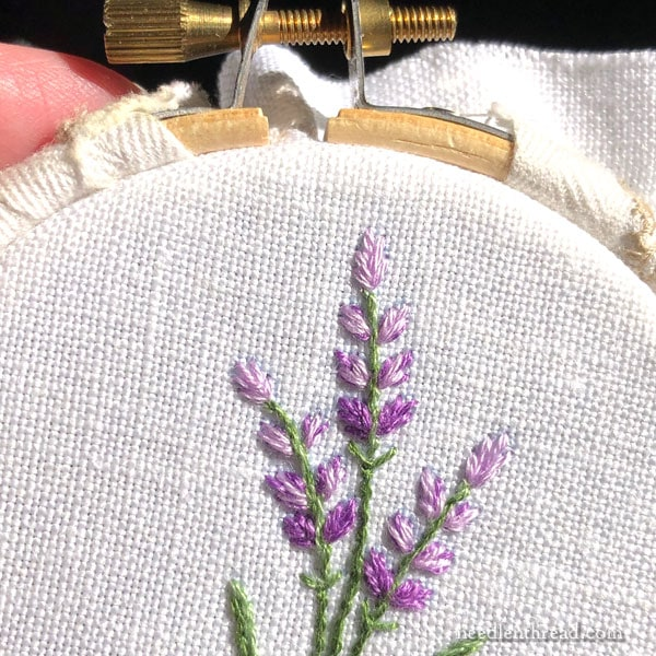Small floral sprig in simple embroidery