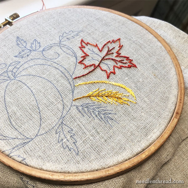 Pumpkin and leaves autumn embroidery project on linen
