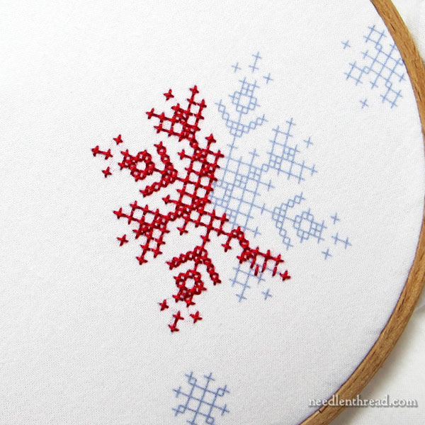 Folky Flakes stamped cross stitch snowflake designs for holiday stitching