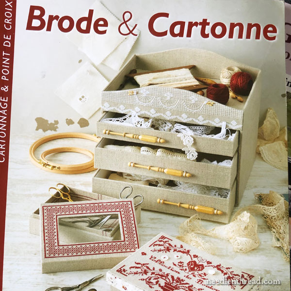 cartonnage or box making with fabric, paper, or embroidery
