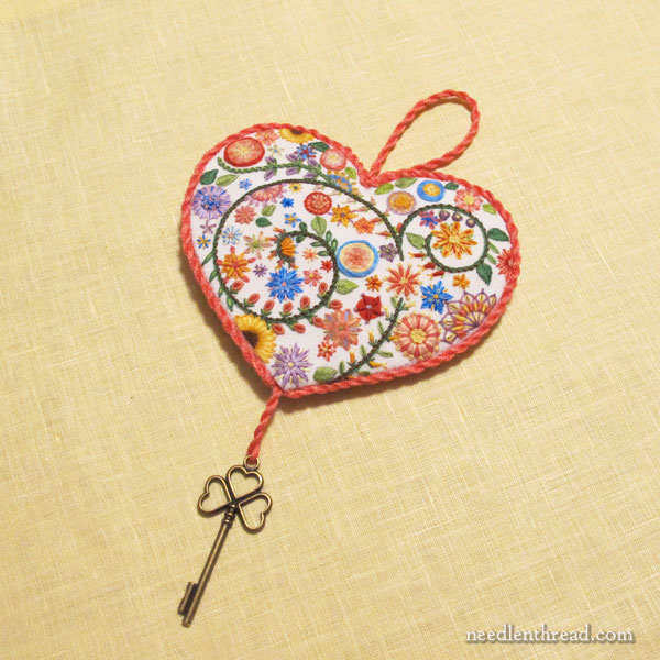 Hand embroidered floral heart with key