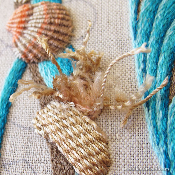 Embroidering a striped seashell