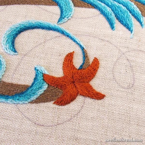 Embroidered monogram M with seashells
